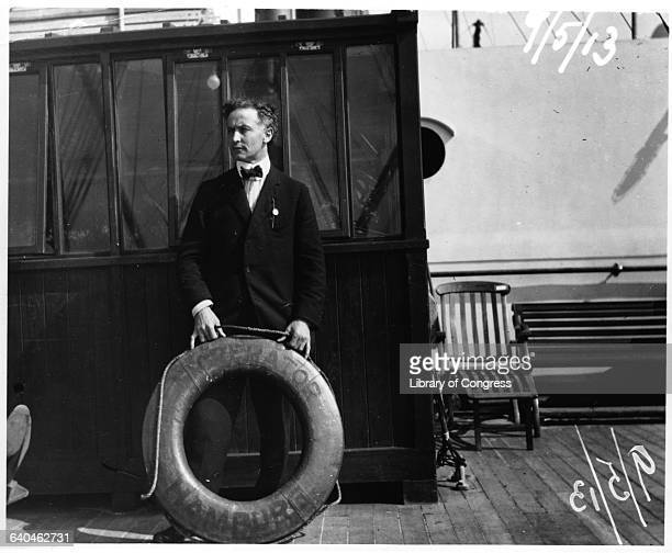 Escape artist Harry Houdini stands on the deck of the Hamburgbased passenger liner SS Imperator holding a life preserver   Location abroad SS...