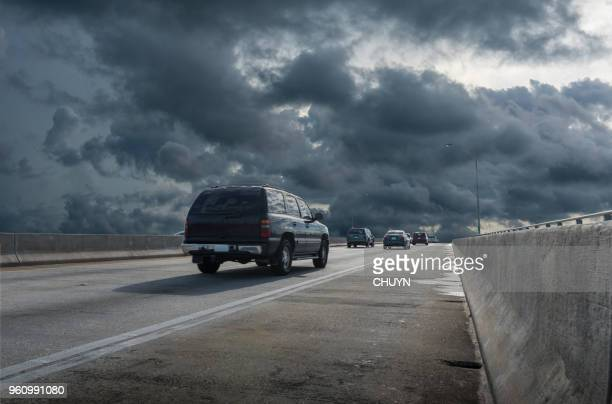 escape - storm season tornadoes stock photos and pictures