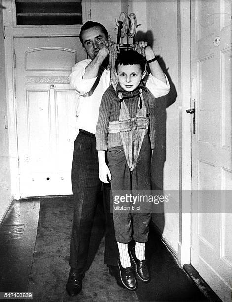 Escapes and escape attempts from East Germany Flight of the Holzapfel family from East to West Berlin the father and his son are demonstrating the...