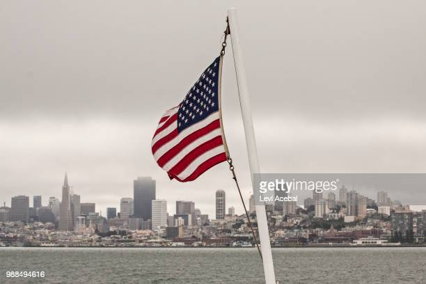 escaping alcatraz - american flag ocean stock pictures, royalty-free photos & images