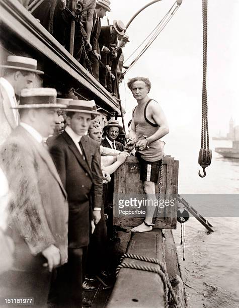 Escapologist Harry Houdini born Erik Weisz prepares to perform one of his most famous publicity stunts the overboard box escape in New York's East...