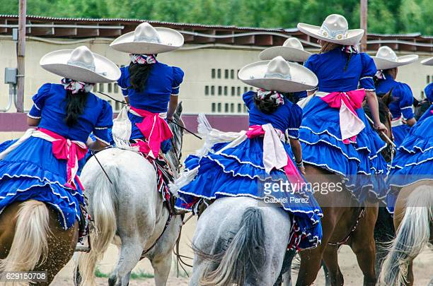 escaramuzas demonstrating their equestrian skills - mexican fiesta stock pictures, royalty-free photos & images