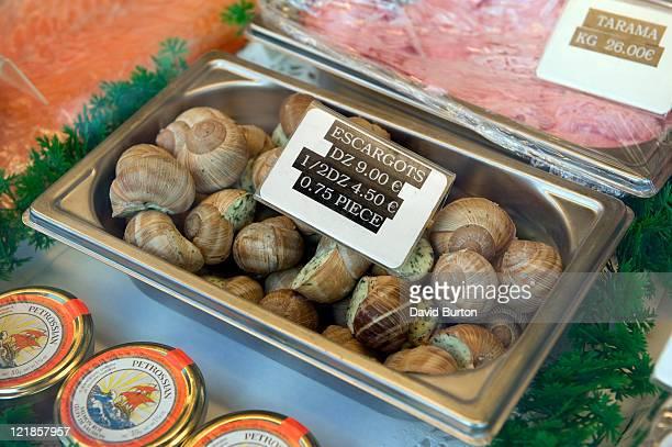 Escargots, Taramasalata and Smoked Salmon for Sale in Deli Window, France