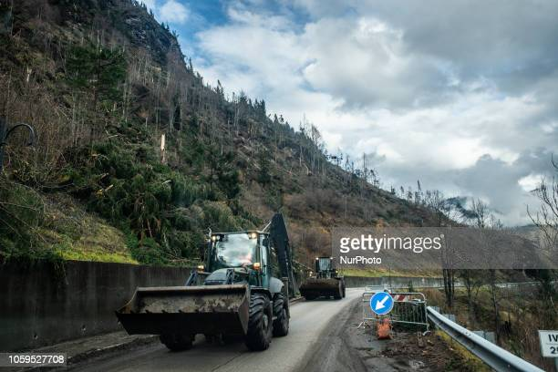 Escavators clearing up a road in disaster-hit in the Dolomites Mountains of Colle Santa Lucia, Belluno Province, in Italy, destroyed and torn by bad...