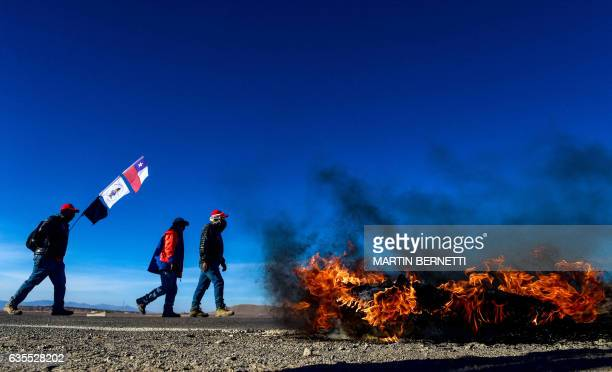 TOPSHOT Escondida copper mine miners on strike block a road in Antofagasta Chile on February 15 2017 Workers at the world's largest copper mine BHP...