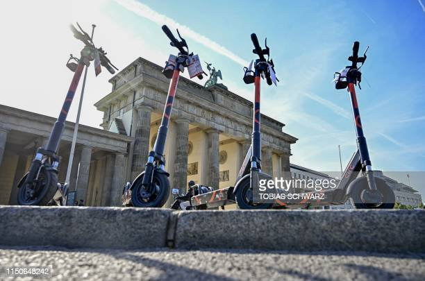 Escooter for rent are parked near the landmark Brandenburg Gate in Berlin on June 19 2019 Germany had authorised on last May 17 2019 batterypowered...