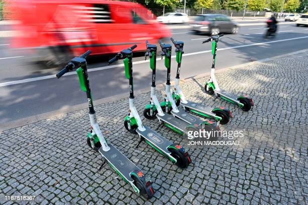 Escooters are parked on the roadside on September 13 2019 in Berlin The use of the batterypowered scooters is allowed in Germany since three months