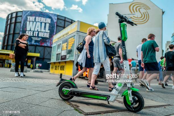 Escooters from scootersharing company Lime are seen at Berlin's Checkpoint Charlie on June 23 2019 Germany authorised batterypowered scooters on its...