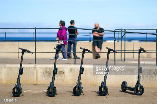Scooters sit parked on the promenade during a trial of rental e-scooters by Ginger Teleporter Ltd., in Redcar, U.K on Monday, Aug. 24, 2020. The U.K....