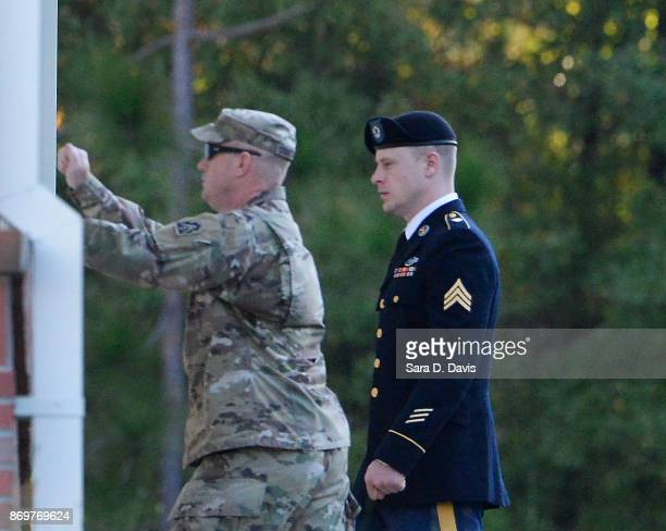 Escort for US Army Sgt Robert Bowdrie 'Bowe' Bergdahl knocks at a side door as they arrive at the Ft Bragg military courthouse for deliberations...