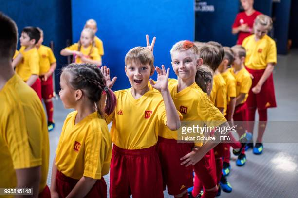 Escort kids of McDonalds have fun prior to the 2018 FIFA World Cup Russia Semi Final match between Belgium and France at Saint Petersburg Stadium on...