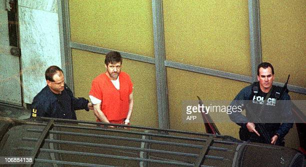 Unabomber suspect Theodore Kaczynski is lead out by armed US marshalls at the Federal Courthouse 22 January in Sacramento CA Kaczynski admitted he...
