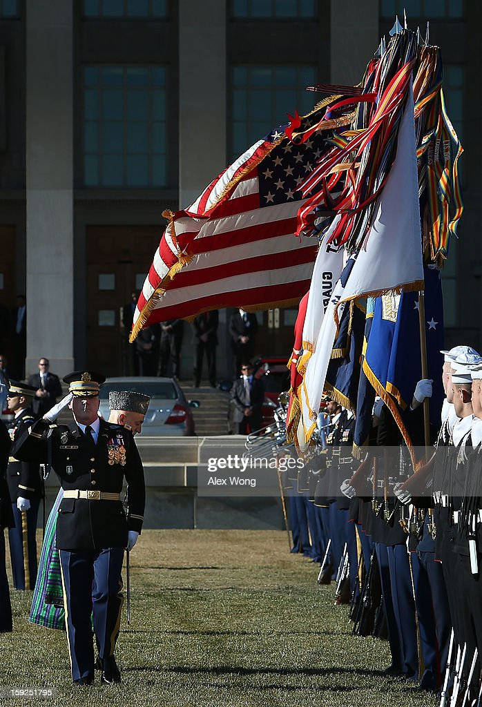 Escorted by Commander of Troops Col. James Markert (L), Afghan President Hamid Karzai (2nd L) bows as he reviews the honor guards during a full military honors ceremony welcoming Karzai to the Pentagon January 10, 2013 in Arlington, Virginia. Karzai is on a visit in Washington, including a meeting with U.S. President Barack Obama at the White House, to discuss the continued transition in Afghanistan and the partnership between the two nations.