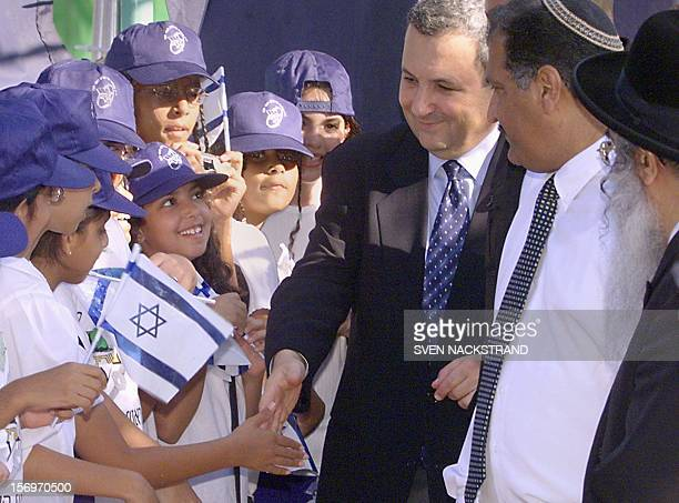 Escorted by Mayor Yigal Yosef and town Rabbi Azaria Basis , Israeli Prime Minister Ehud Barak greets children in Rosh Haayin, a small town populated...