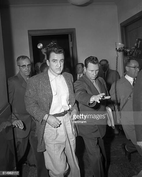 Escorted by San Quentin prison guards JR Thomas and Lt LJ Morin Caryl Chessman condemned to death more than seven years ago enters the Post Office...