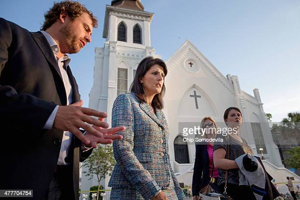 Escorted by staff and security, South Carolina Governor Nikki Haley moves from one television interview to another across from the historic Emanuel...