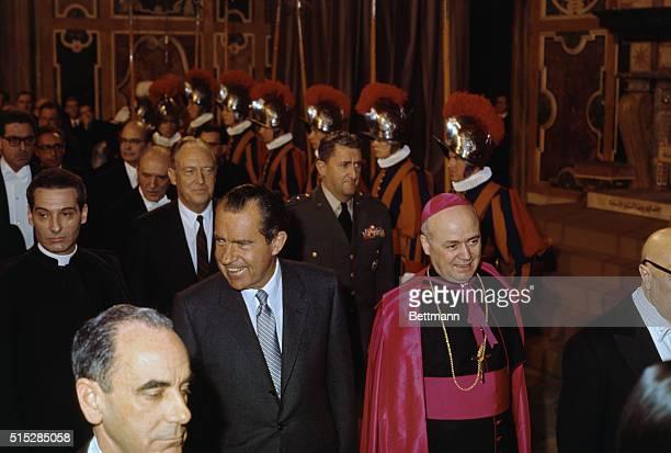 Escorted by Vatican Undersecretary of State Monsignor Giovanni Benelli President Richard Nixon and US Secretary of State William P Rogers walk past...