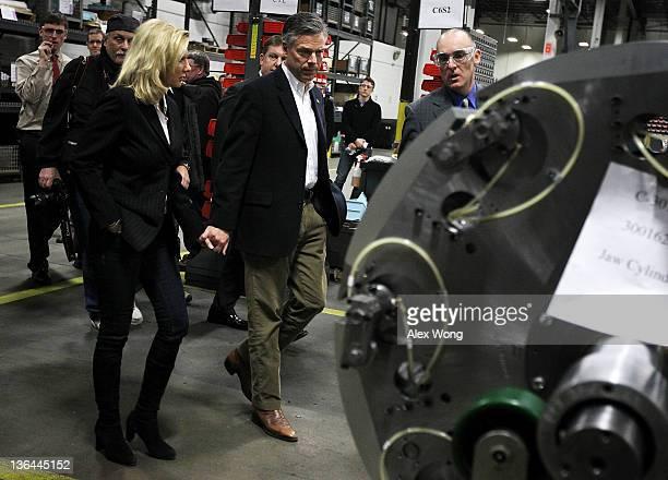 Escorted by VP of North American Operation of Goss International Chris Sieracki Republican presidential candidate former Utah Gov Jon Huntsman tours...