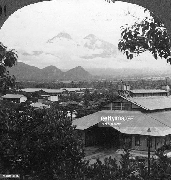 Escuintla Guatemala c1900s In the distance can be seen the city's twin volcanoes Fuego and Acatenango Stereoscopic card Detail