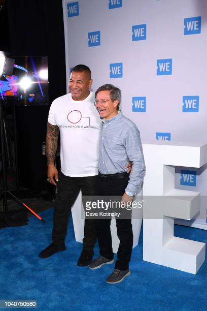 Esera Tuaolo and chairman and CEO Allstate Tom Wilson attend WE Day UN 2018 at Barclays Center on September 26 2018 in New York City