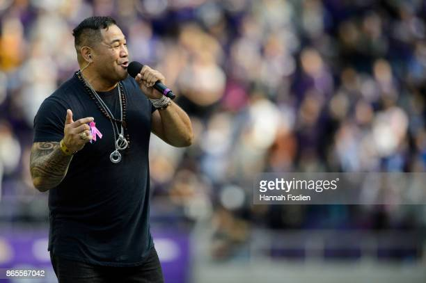 Esera Tuaolo retired NFL player and contestant on The Voice performs during halftime of the game between the Minnesota Vikings and the Baltimore...