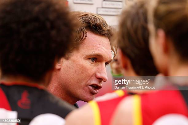 esEssendon ach James Hird speaks with his players during the round 15 AFL match between the Essendon Bombers and the Melbourne Demons at Melbourne...
