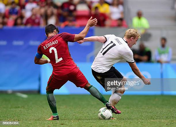 Esgaio Ricardo of Portugal battles for the ball against Julian Brandt of Germany in the first half during the Men's Football Quarterfinal match on...