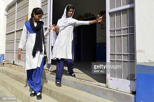 Esham Masih and Esha Masih daughters of Asia Bibi a Pakistani Christian mother sentenced to death in under blasphemy laws leave their school in...