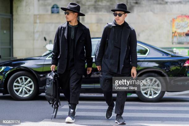 Eshan Kali and John Jarrett outside Y3 during Paris Fashion Week Menswear Spring/Summer 2018 Day Five on June 25 2017 in Paris France