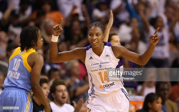 Eshaya Murphy of the Phoenix Mercury reacts after hitting a three point shot past Epiphanny Prince of the Chicago Sky during the second half of game...