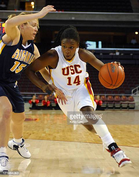 Eshaya Murphy of USC drives past Krista Foster of California during Pacific-10 Conference women's basketball game at the Galen Center in Los Angeles,...