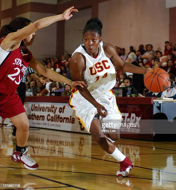 Eshaya Murphy of USC drives past Rosalyn GoldOnwude of Stanford during 7869 loss in Pacific10 Conference women's basketball game at the Lyon Center...