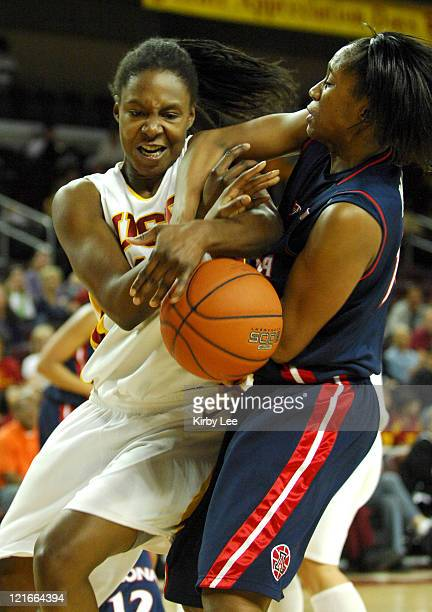 Eshaya Murphy of USC left and Linda Pace of Arizona battle for control of ball in Pacific10 Conference women's basketball game at the Galen Center in...