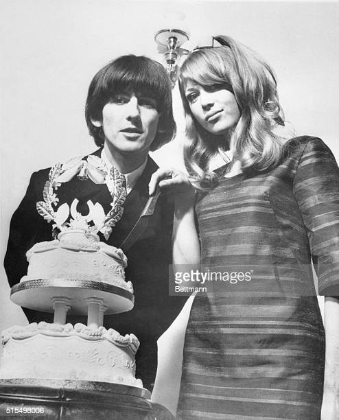 Beatle Wedding Beatle George Harrison and model Patti Boyd cut the wedding cake during the reception at his home here following their marriage...