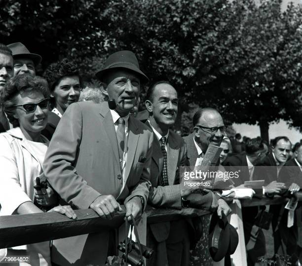Esher Surrey England 11th September 1961 American film actor Bing Crosby smoking a pipe as he enjoys a day out at the races at Sandown Park where he...