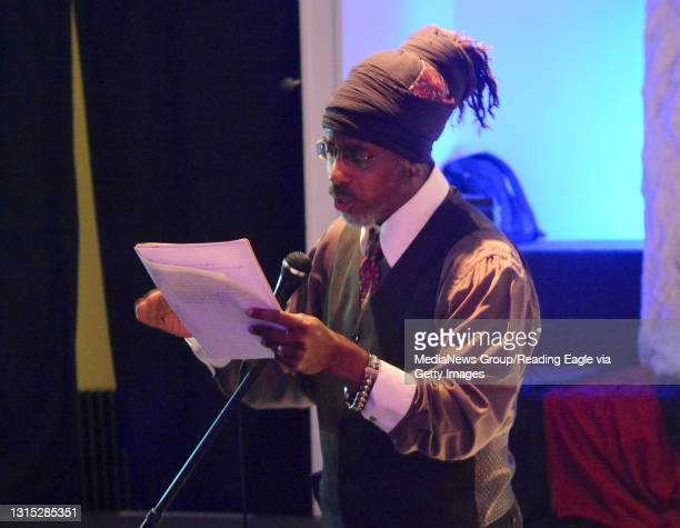 """Eshu """"Gingerbread Man"""" Suhuykha performs a poem during the Bosses Basketball Association Black and White Affair at the Gallery Above Penn Square on..."""