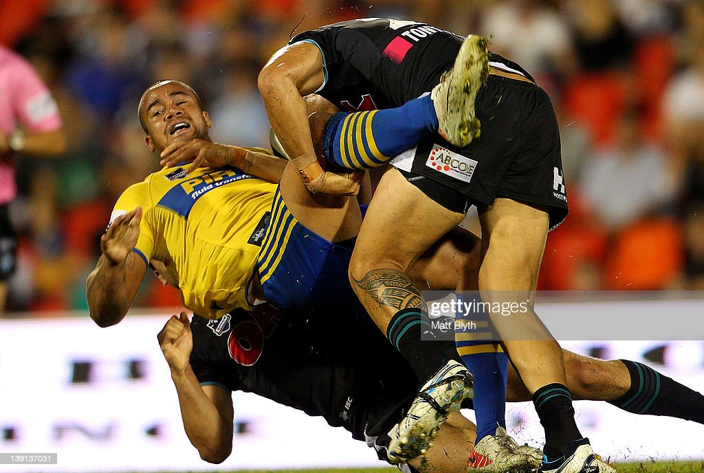Esi Tonga of the Eels is tackled during the NRL trial match between the Penrith Panthers and the Parramatta Eels at Centrebet Stadium on February 17, 2012 in Sydney, Australia.