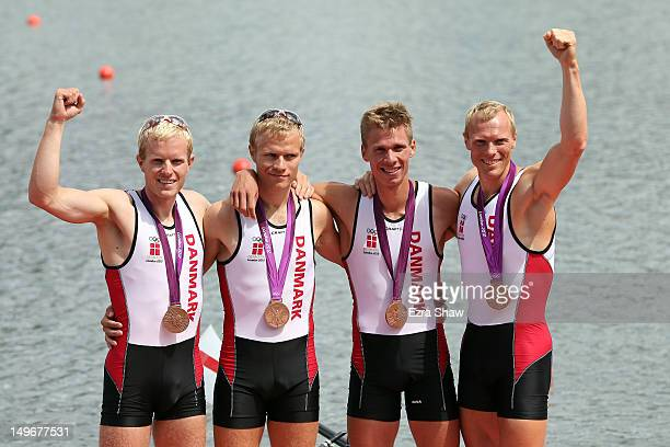 Eskild Ebbesen Jacob Barsoe Morten Jorgensen and Kasper Winther of Denmark celebrate with their bronze medals during the medal ceremony for the...