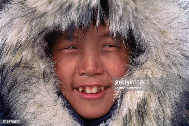 eskimo wearing fur lined coat - inuit stock pictures, royalty-free photos & images