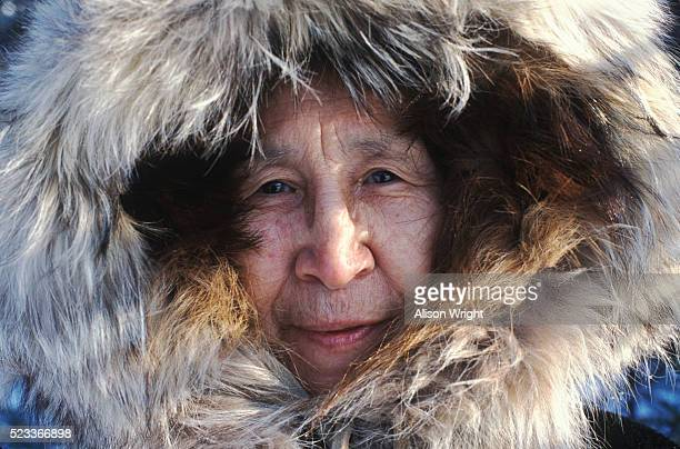 eskimo woman in fur hood - inuit stock pictures, royalty-free photos & images