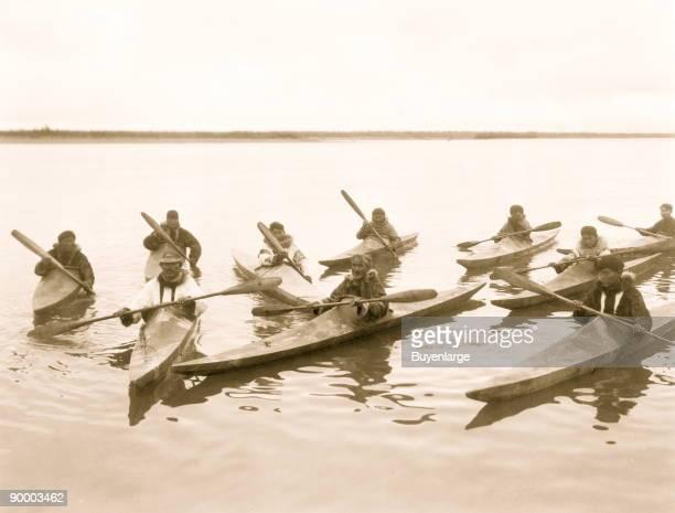 Eskimos in kayaks Noatak Alaska