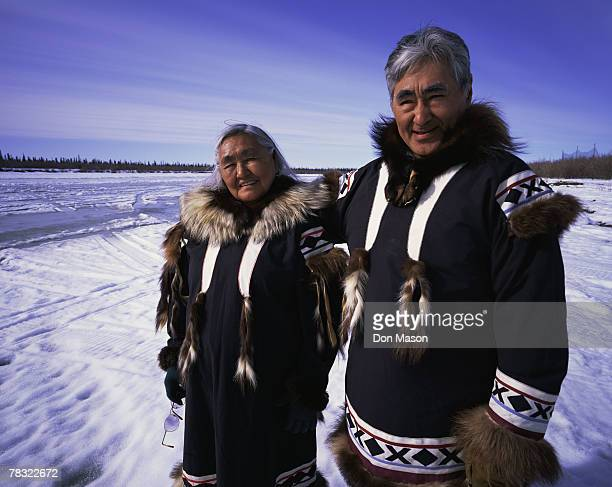 eskimos in traditional clothing - inuit stock pictures, royalty-free photos & images
