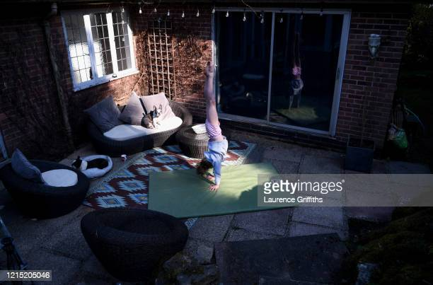 Esmé Griffiths of Robin Hood Gymnastics trains in isolation in her home on March 27 2020 in Nottingham England Coronavirus pandemic has spread to at...