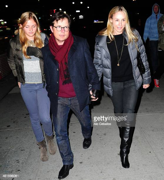 Esme Annabelle Fox Michael J Fox and Tracy Pollan seen arriving at Madison Square Garden on January 9 2014 in New York City