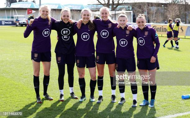 Esme Morgan, Ellie Roebuck, Niamh Charles, Millie Turner, Beth England and Georgia Stanway of England pose for a photo during an England Training...