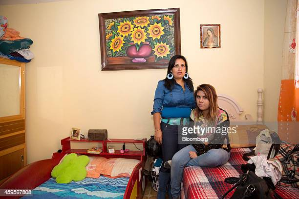Esmeralda Velazquez a machine operator at an auto suspension plant left stands for a photograph with her daughter Daniela in Queretaro Mexico on...