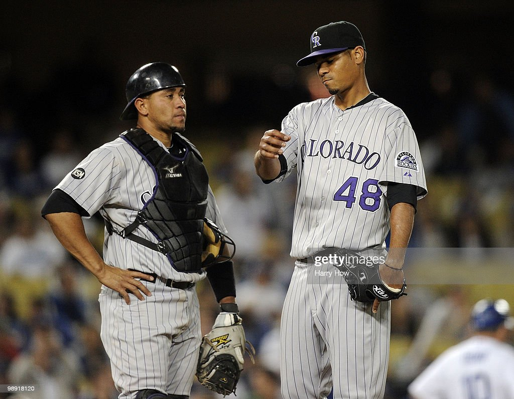 Esmil Rogers #48 and Miguel Olivo #21 of the Colorado Rockies reacts after allowing three runs to the Los Angeles Dodgers during the fifth inning at Dodger Stadium on May 7, 2010 in Los Angeles, California.