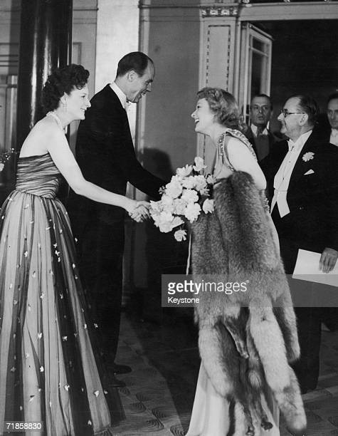 Esmond Cecil Harmsworth 2nd Viscount Rothermere the chairman of Associated Newspapers welcomes English actress Anna Neagle and her husband...