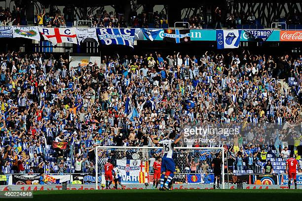 Espanyol fans celebrate after Sergio Garcia of RCD Espanyol scores his team's first goal during the La Liga match between RCD Espanyol and Sevilla FC...