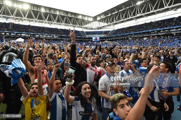 Espanyol fans run onto the pitch as they celebrate winning a UEFA Europa League position next season at the end of the La Liga match between RCD...